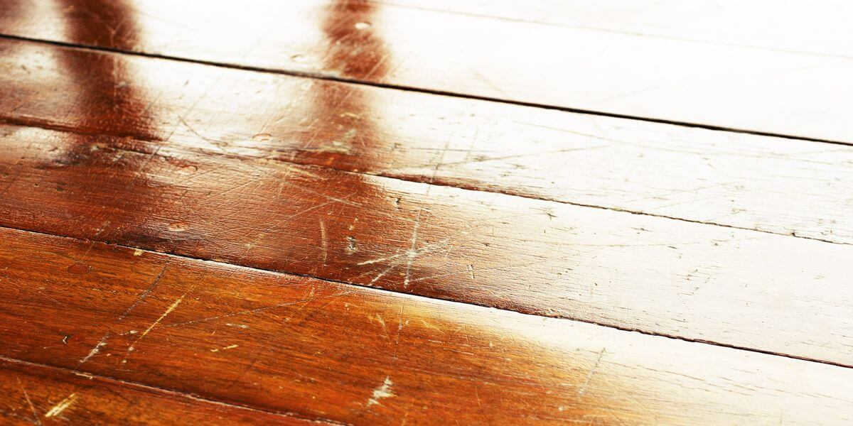 how to use sandpaper to remove scratches from wood furniture
